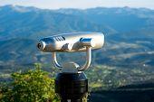 stock photo of spyglass  - Modern silver spyglass on the mountain viewpoint - JPG