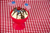 foto of sprinkling  - American flags on a hot fudge sundae with red - JPG