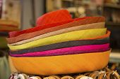 stock photo of panama hat  - The pile of colorful straw woman hats