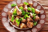stock photo of cilantro  - Duck Hearts in butter with cilantro shot from above - JPG