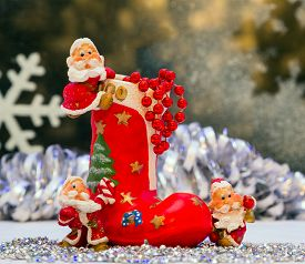 stock photo of gnome  - Gnomes of Christmas toy and boots for gifts - JPG