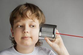 picture of tin man  - beauty boy listen tin can telephone - JPG
