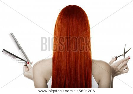 Red hair and hairdresser's tools