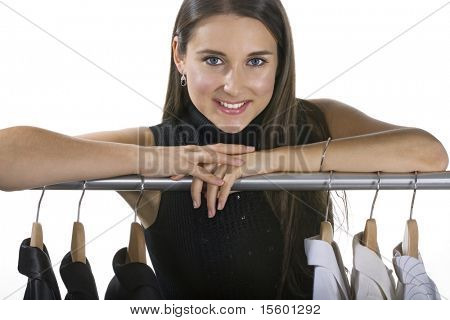Smiling woman presenting selection of jackets.