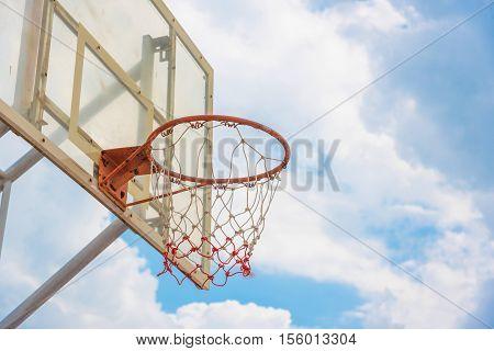 Basketball hoop on a blue sky in Thailnd .