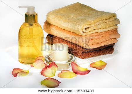 Bath and spa items with rose petals in warm colors