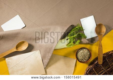 Fresh root and fennel seeds on a wooden brown background