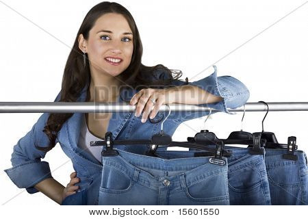 Smiling woman presenting selection of jeans