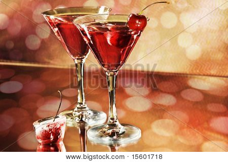 Red cocktail in a martini glasses on holiday background