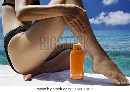 Beautiful woman taking sunbath near the ocean