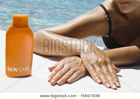 Beautiful woman taking sunbath near the ocean