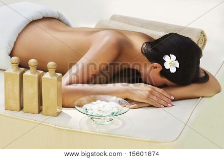 Beautiful woman getting spa treatment at daylight outdoor