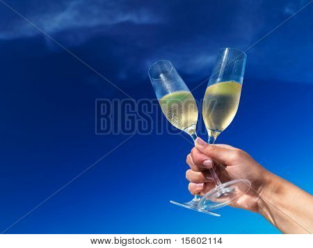 Champagne flutes against blue sky