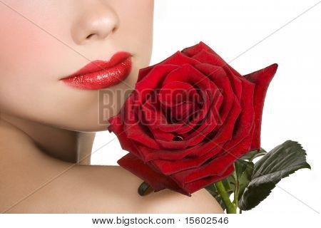 Woman with red lips and red rose