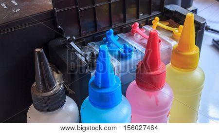 bottle of ink and printer ink tank side