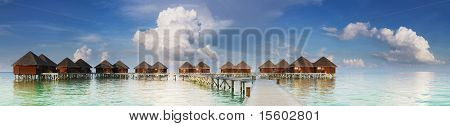 Panoramic view on water villas at tropical resort