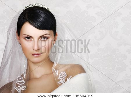 Beautiful bride on refined background. Space for text.