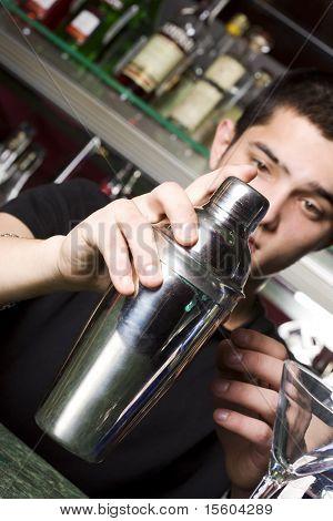 Barman with shaker. Focus on shaker.