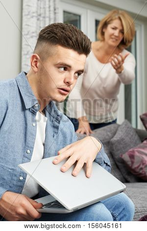 Teenage Boy Hiding Internet Use From Mother