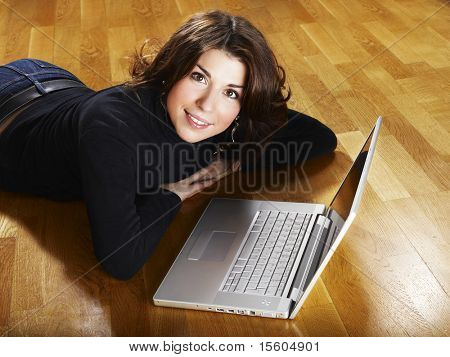 Woman spending her time at home using laptop