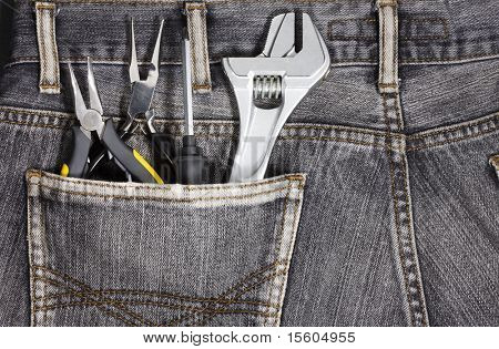 Tools in the pocket of craftsman jeans