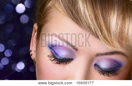 Blue makeup. Eyes with long eyelashes.
