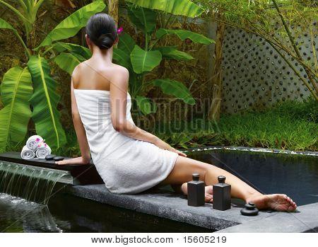 Woman getting spa treatment at tropical resort