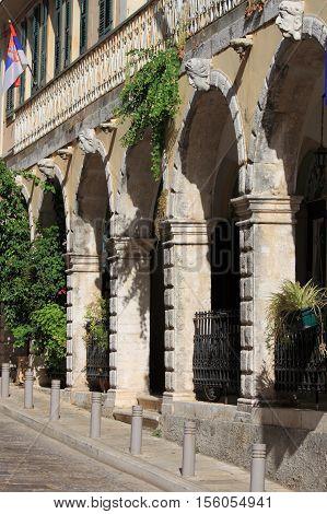 Street with portico in Corfu Island, Greece