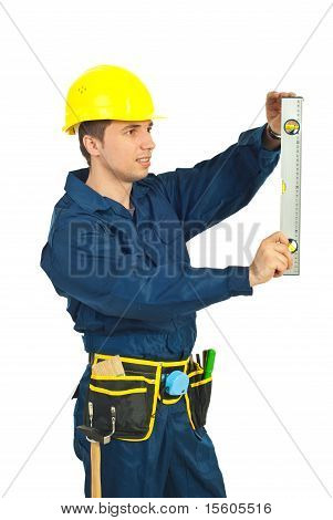 Young Worker Measure With Bubble Level