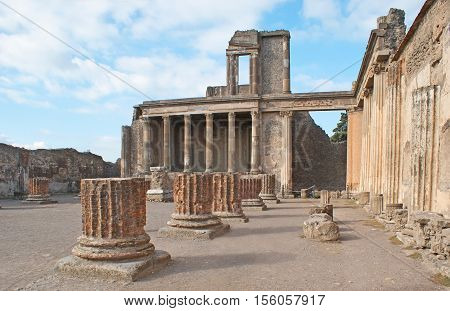 The ruins of Jupiter Temple with the massive green columns in front of it Pompeii Italy.