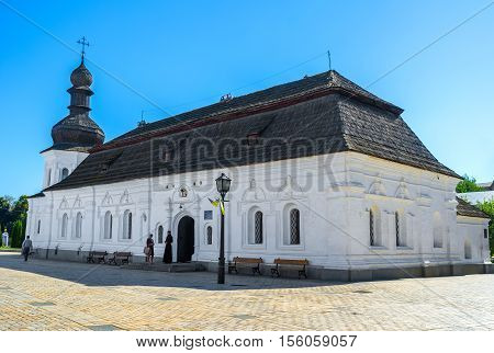 KIEV UKRAINE - SEPTEMBER 8 2016: Panorama of medieval Refectory of St John the Divine with the roof and onion dome covered with wood shingles on September 8 in Kiev.