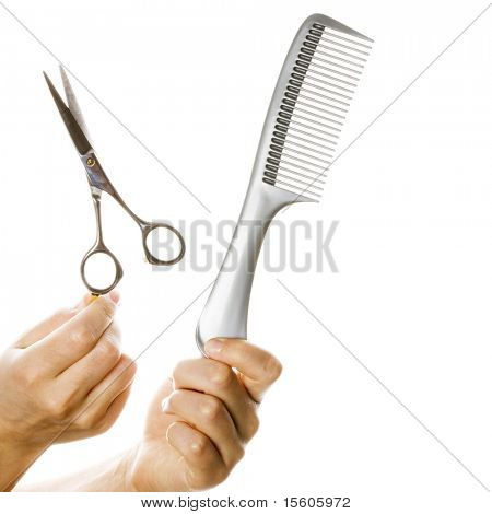 Hairdresser hands with work tools on white