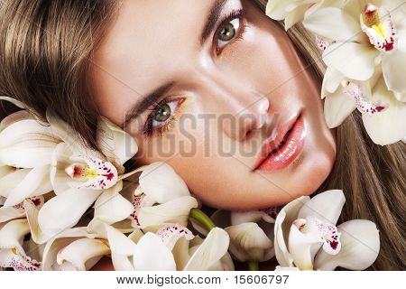 Woman with beautiful makeup and white orchids