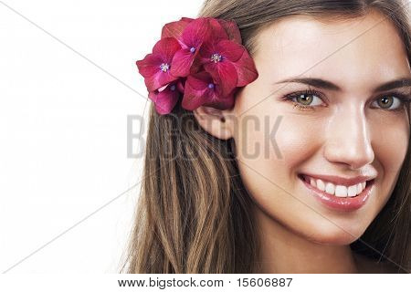 Smiling beautiful woman with purple flowers. Space for text.