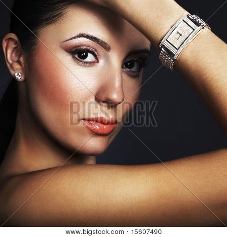 Tanned beauty with silver wristwatch