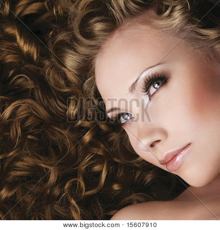 Woman with beautiful makeup and long curly hair