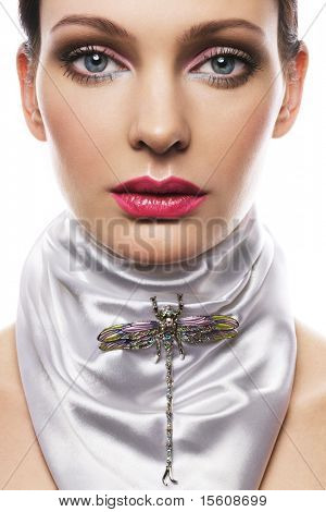 Beautiful woman with white silk scarf and brooch