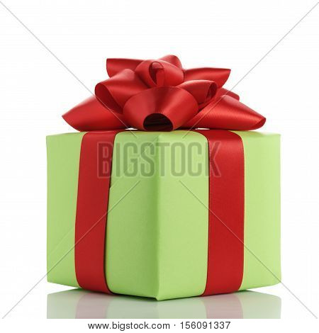 small green gift box with red ribbon bow isolated on whitebackground