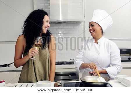 Cookery course: pouring wine into a pan with risotto