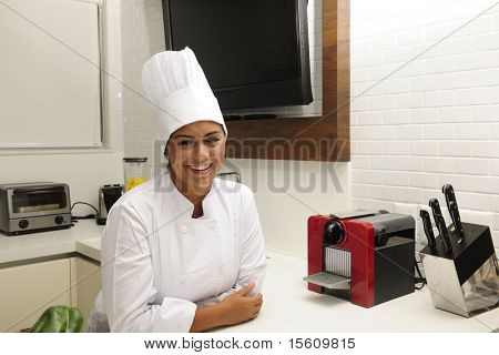 Portrait of a happy chef  cooking in kitchen