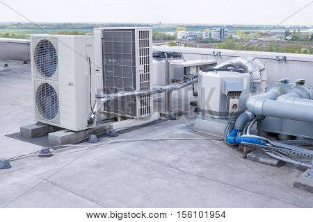 equipment installation of air conditioning on the roof of a skyscraper