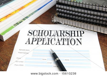 blank scholarship  application on desktop with books