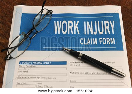 insurance: blank work injury claim form on desk