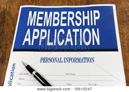 membership application form on a desk with pen
