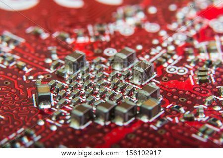 Electronic circuit board close up. Red PCB