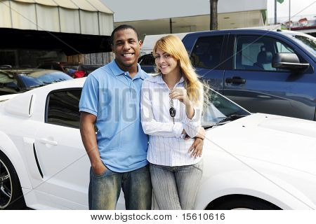 happy multiethnic couple buying a new car