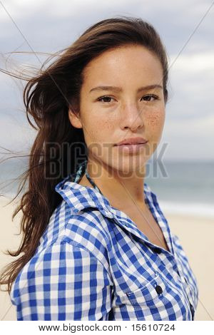individuality: portrait of a beautiful young woman at the sea
