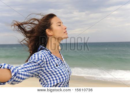 freedom: woman enjoying the wind and the sea