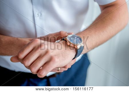 businessman clock clothes, businessman checking time on his wristwatch. men's hand with a watch, watch on a man's hand, putting the clock on the hand, fasten clock watch time, man's style
