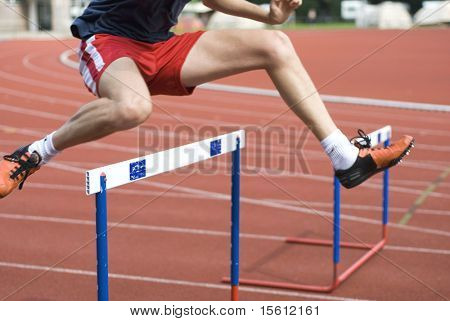 man is jumping over the hurdle